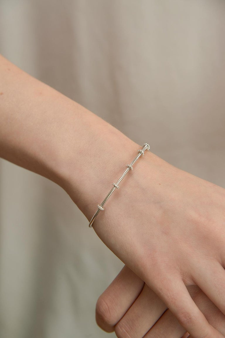 Diamond bar bracelet in 14 k white gold.  6.1 inches wide