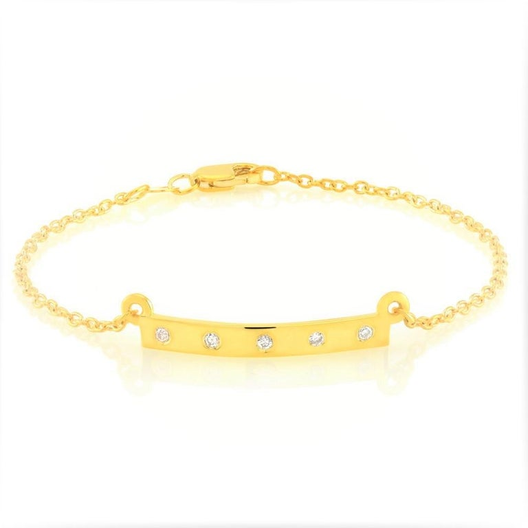 Sterling Silver link bracelet  Five diamond pave set on one-inch bar  Lobster claw clasp Five diamond weighing 0.15 carat  Bracelet seven inch long  New bracelet Yellow gold plated