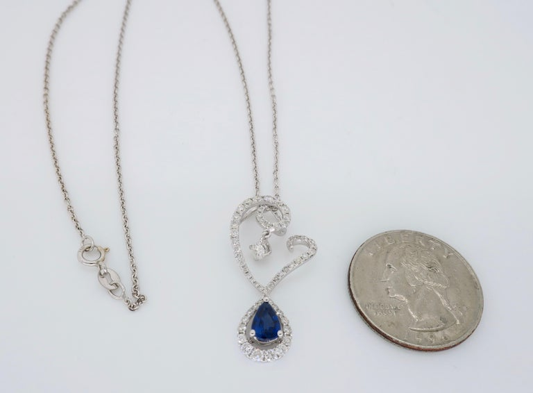 Pear Cut Diamond and Blue Sapphire Drop Pendant Necklace in 18 Karat White Gold For Sale
