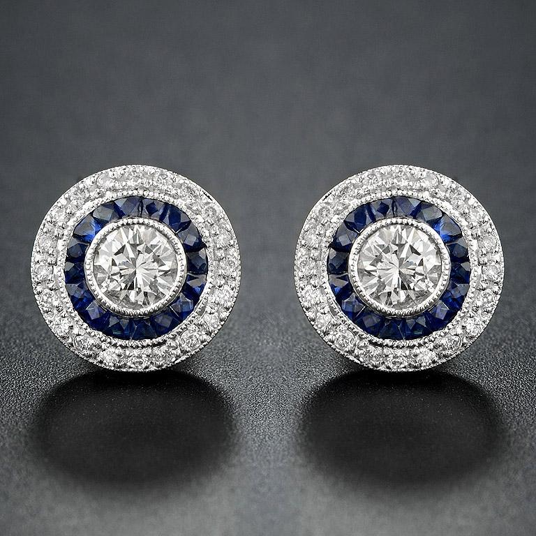 Diamond Blue Sapphire Stud Earrings, one of the most popular Art Deco Style.     Center Diamond ( H color SI Clarity, round, size 4.4 mm.) 2 pieces 0.65 Carat.  French Cut Natural Blue Sapphire 32 pieces 2.24 carat.  Surrounding with Diamond (Round