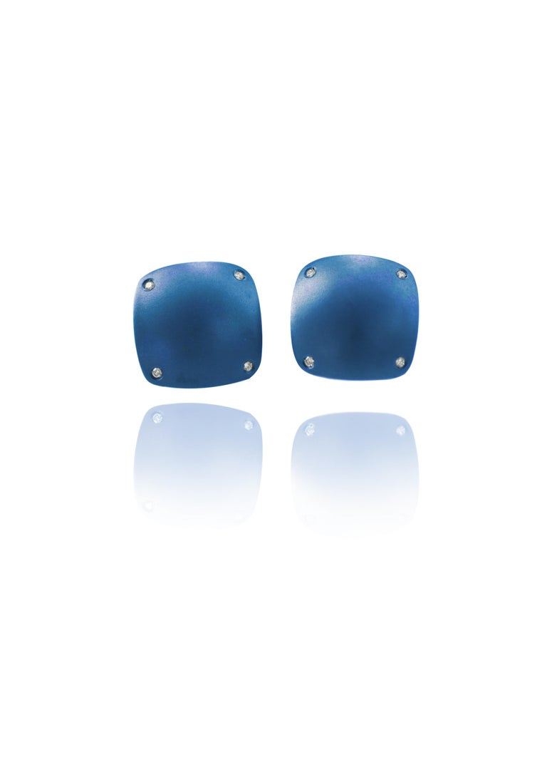 Handcrafted in Margherita Burgener family factory the contemporary yet classic cufflinks are squared, slightly bombé, rounded angles and they feature 8 little diamonds. The back, same shape, in a smaller size, with no diamonds.    They can be