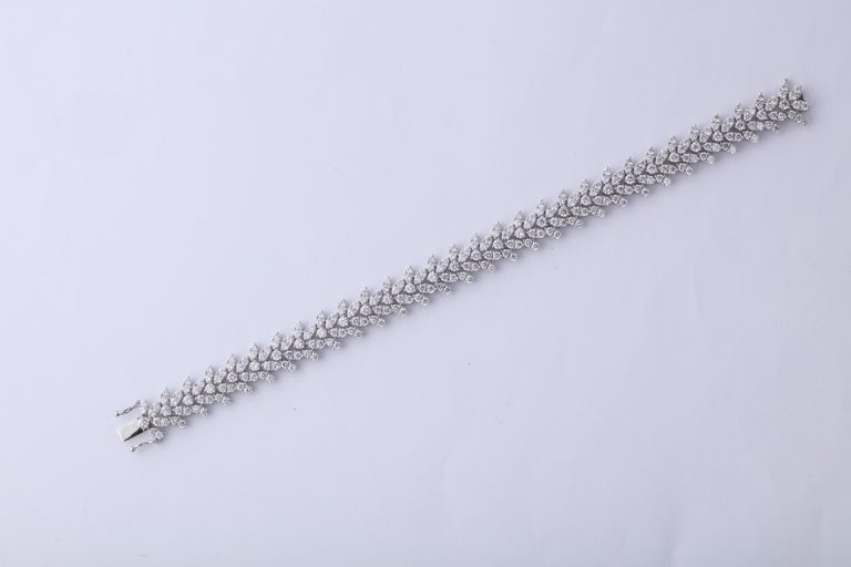 Beautiful diamond bracelet.  9.17 carats of round brilliant cut diamonds set in a wreathe design.   18k white gold   Approximately 10.70 mm wide, 7 inch length.   An elegant diamond bracelet designed to compliment pieces in your existing