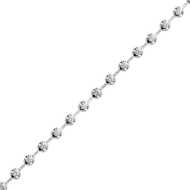 This beautiful bracelet gives a new appearance to the classic tennis bracelet. This 18 karat white gold bracelet weighing 7.7 grams has 30 round VS2, G color diamonds totaling 0.96 carats.