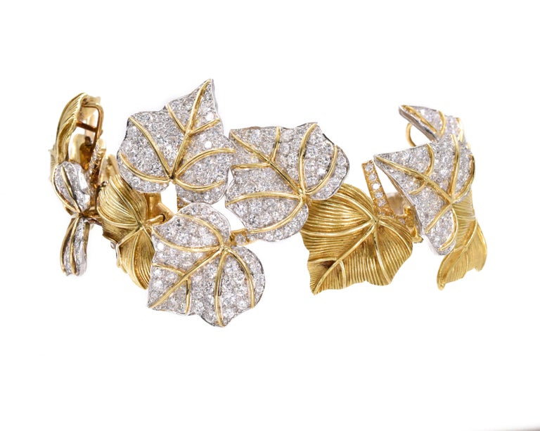 Gold and diamond bracelet  Designed as a branch of ivy leaves of textured gold and set with brilliant-cut diamonds, Diamonds estimated to weigh a total of approximately 20 carats, diamonds are near colorless & VS clarity Gold weight is approximately