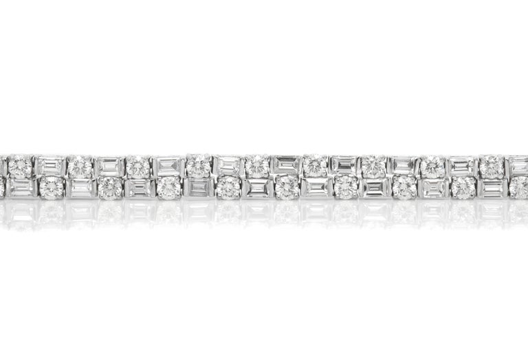 Bracelet, finely crafted in bezel platinum setting with round and emerald cut diamonds weighing approximately a total of 13.81 carat. Circa 2000.