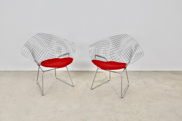 Pair of armchairs in chromed metal and red fabric. Wear due to time and age of the armchairs.