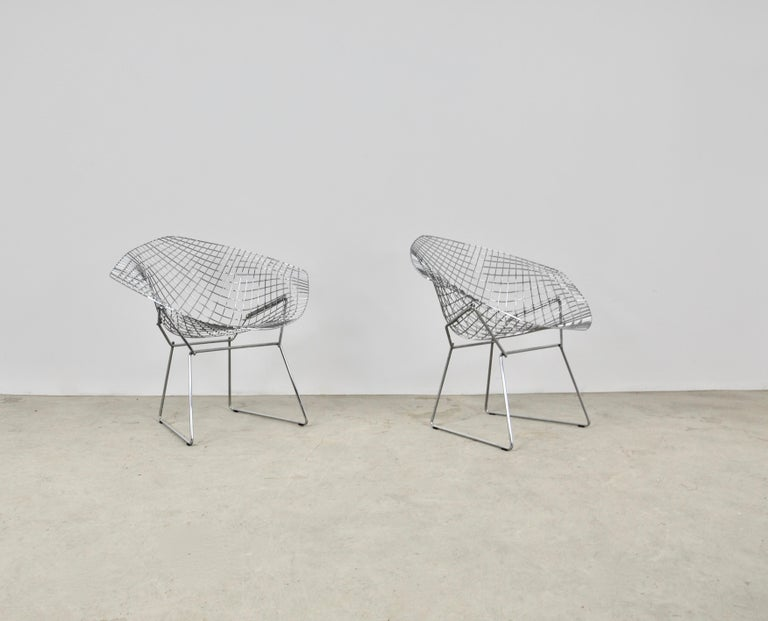 Pair of chromed metal armchairs. wear due to time and age of the armchairs.