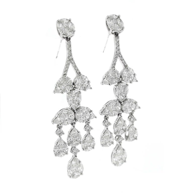 Fantastic looking pair of diamond chandelier earrings. These are clusters of diamonds, rather than individual diamonds. The craftsmanship is so well that it looks like a single stone, but is much less expensive. They are high quality, white diamonds
