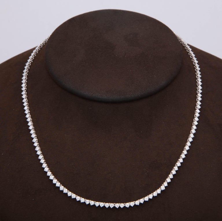 5.65 carats of white round brilliant cut diamonds set in 14k white gold  A perfect choker necklace that can be worn daily and casually or dressed up.   Looks great layered with other pieces as well!  16 inch length, can be ordered longer or