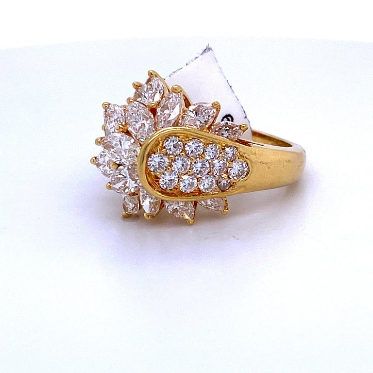 18K Yellow gold cluster ring featuring 18 round brilliants weighing 0.65 carats and 16 marquise diamonds weighing 2.49 carats.  Color G Clarity SI  Size 6.75 Sizeable free of charge.