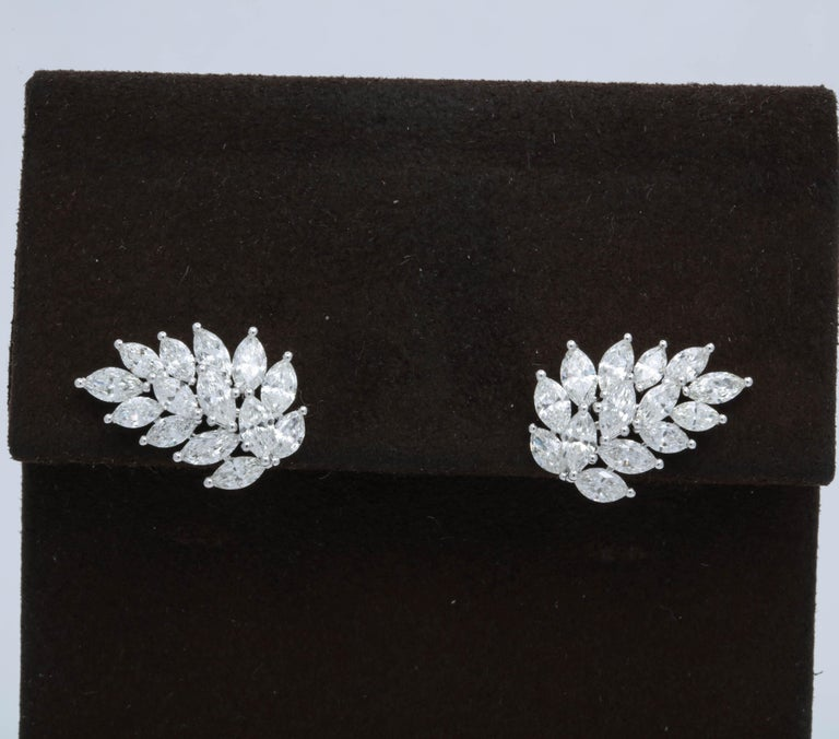A versatile pair of cluster earrings -- full of SPARKLE!  4.57 carats of white marquise cut diamonds set in 18k white gold.  The earrings have a push back closing (like a stud earring) so they can be worn sideways to cuff the ear or in any position