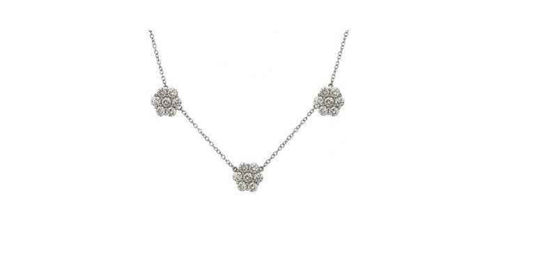 Three cluster necklace featuring 21 round brilliants weighing 4.02 carats in 18k white gold.   Can be made in any size, gold color or gemstone. Build your own!