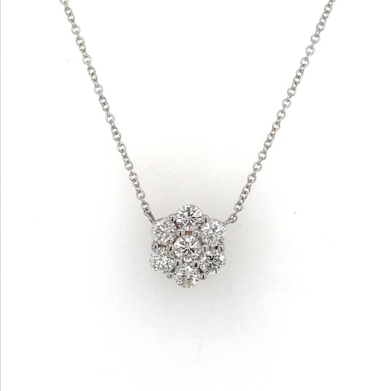18K White Gold diamond cluster pendant featuring 7 round brilliants weighing 0.79 carats extended on a 16 inch chain.  A timeless piece of jewelry.  Also available in earrings.  Color: H Clarity SI1