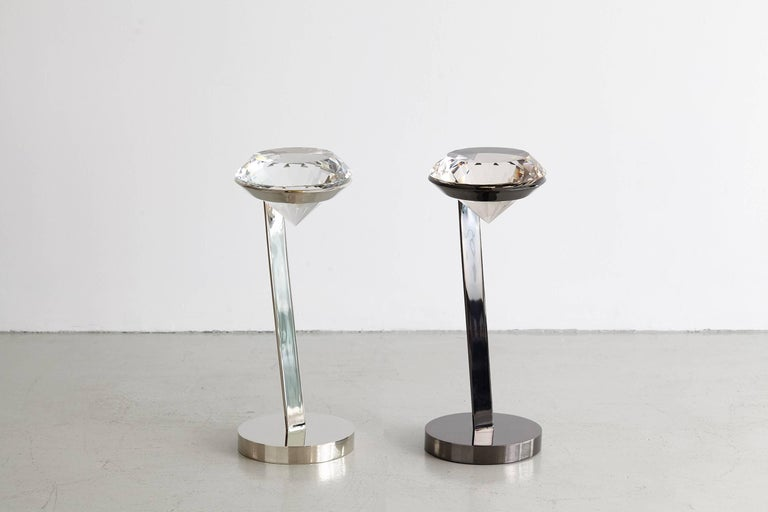 Witty cigarette or cocktail table with giant diamonds as table tops.  Great for a posh bathroom or next to a chic accent chair.  Available in a polished nickel and blackened nickel finish. Sold individually. One available in polished nickel. Two