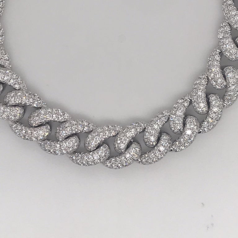 14K White gold Cuban link bracelet featuring 672 diamonds weighing 7.60 carats. Color F-G Clarity VS  Available in yellow and rose gold.