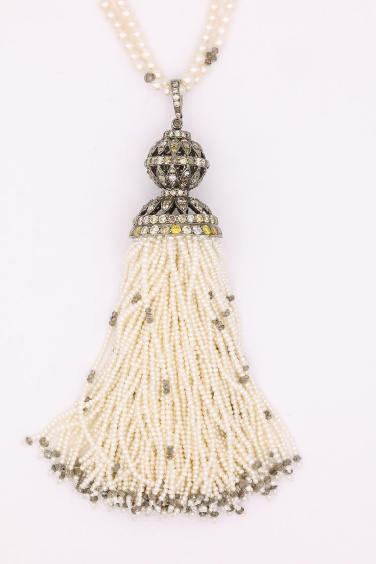 Gorgeous 51 inch tassel necklace featuring 124 tassel strands, measuring 4 1/2 inches, with touches of diamond beads throughout weighing approximately 7 carats and a pave diamond cap of cognac diamonds weighing approximately 5.50 carats.  Can be