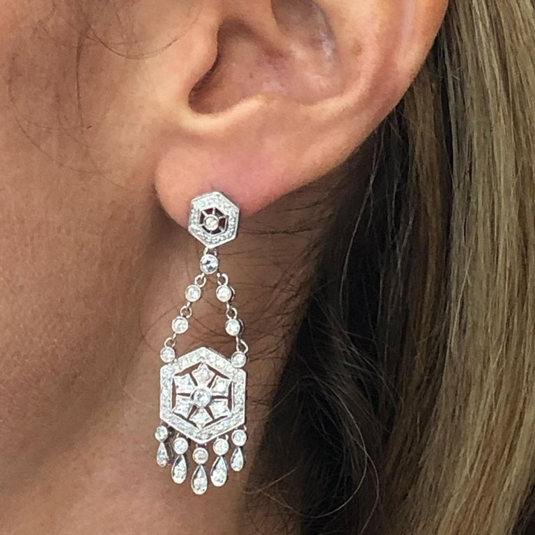 These fabulous diamond dangle chandelier earrings are crafted in 18 karat white gold. The 2.0 inch drops feature 1.72 carat total weight of round brilliant cut white diamonds graded H-I/SI. The earrings are just the right length and comfortable to