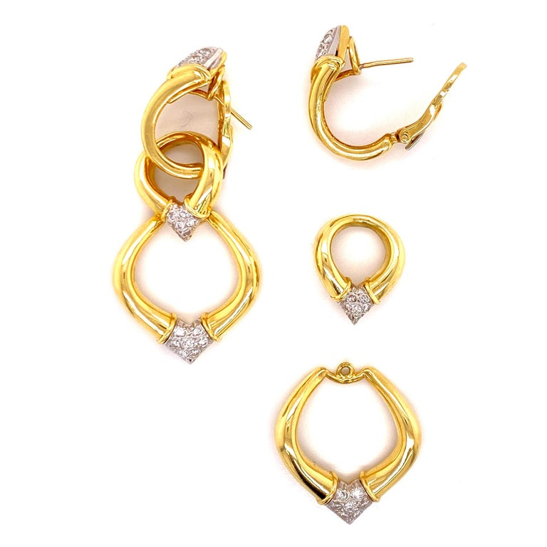 Stunning diamond dangle earrings fashioned in 18 karat yellow gold. The earrings feature round brilliant cut diamonds graded G-H color and VS clarity. The detachable links allow the earrings to be worn at 3 different lengths. The earrings measure 2