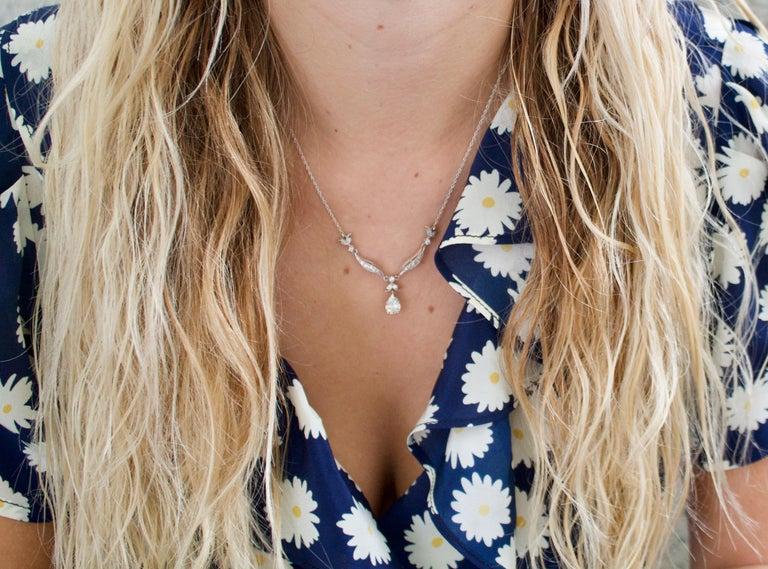 Pear Cut Diamond Dangling Diamond Pear Shape Necklace in Platinum on 14 Karat Chain For Sale