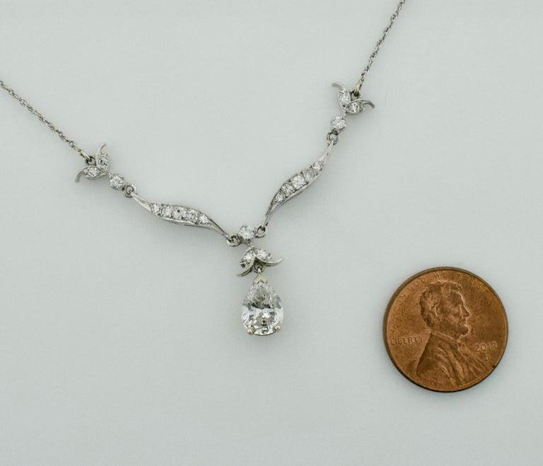 Women's or Men's Diamond Dangling Diamond Pear Shape Necklace in Platinum on 14 Karat Chain For Sale