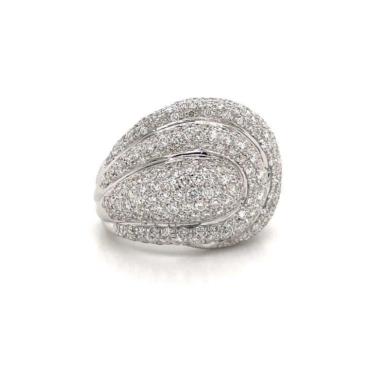 Chic dome cocktail ring featuring 268 round brilliants weighing 4 carats, crafted in 18k white gold.  Color F-G Clarity VS2 Size 7.5, sizeable