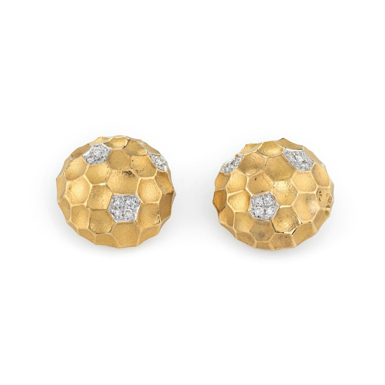 Finely detailed pair of vintage clip earrings, crafted in 18k yellow gold.   Diamonds are pave set into the mounts, totaling an estimated 0.25 carats (estimated at G color and VS2 clarity).  The earrings clip backings.  The earrings are in excellent