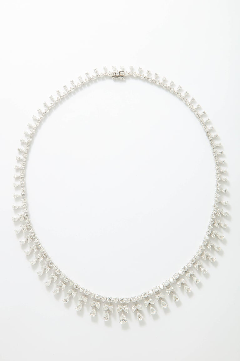 A beautifully designed necklace featuring round and pear shaped diamonds.  23.71 carats set in 18k white gold.  16.5 inches in length but can be adjusted if necessary