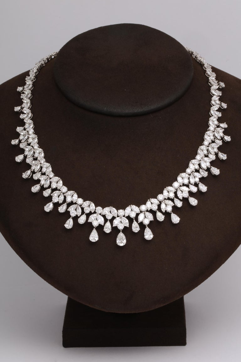 One of our favorite designs, this necklace is SPECTACULAR!!  A timeless design featuring 48.28 carats of white pear, marquise and round cut diamonds set in platinum.   A grand piece -- the perfect addition to any collection.   16 inch length that