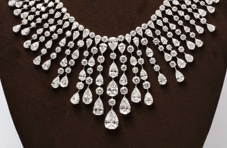 A MASTERPIECE  This important diamond necklace features over 128 carats of white pear shape and round diamonds.   This piece is made up of many diamonds above 1 carat up to the 5 carat pear shaped drop.  The center line drop features 2, 3, and 5