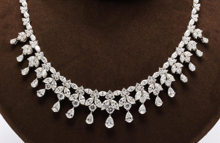 A MAGNIFICENT necklace!!  47.62 carats of white round, pear and marquise cut diamonds set in platinum.   Over 3/4 of an inch wide in the center.   16.5 inch length.