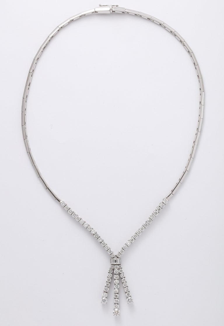 Designed and made in Italy  6.19 carats of round brilliant cut and baguette cut diamonds set in 18k white gold.  16 inch length