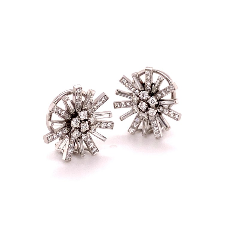 This delicate pair of earclips is handcrafted in 18 karat white gold and carefully set with 84 diamonds of G/H colour and vs clarity, total weight approximately 1.13 carats. (14 brilliant-cut, 56 single-cut, and 14 baguette-cut diamonds)  Diameter