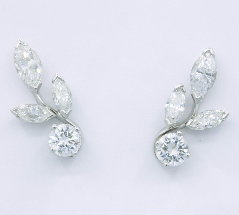 Platinum diamond earring climbers featuring 2 round brilliants, 0.70 cts, and 6 marquise diamonds weighing 1.00 cts.  A very sweet pair to have in your collection!