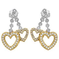 A Pair of Diamond Love, Tasteful Hearts Earrings in 18 Karat Gold