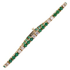 Diamond Emerald 14 Karat Yellow Gold Line Tennis Bracelet Round Brilliant