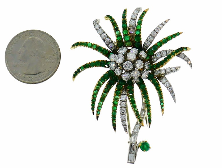 Lovely Chrizantema brooch created in France in the 1960s. Made of 18 karat white gold and platinum, The clip is set with approximately 5 carats of round brilliant and baguette cut diamonds and 2.80 carats of round cabochon emeralds. Weight 31.3