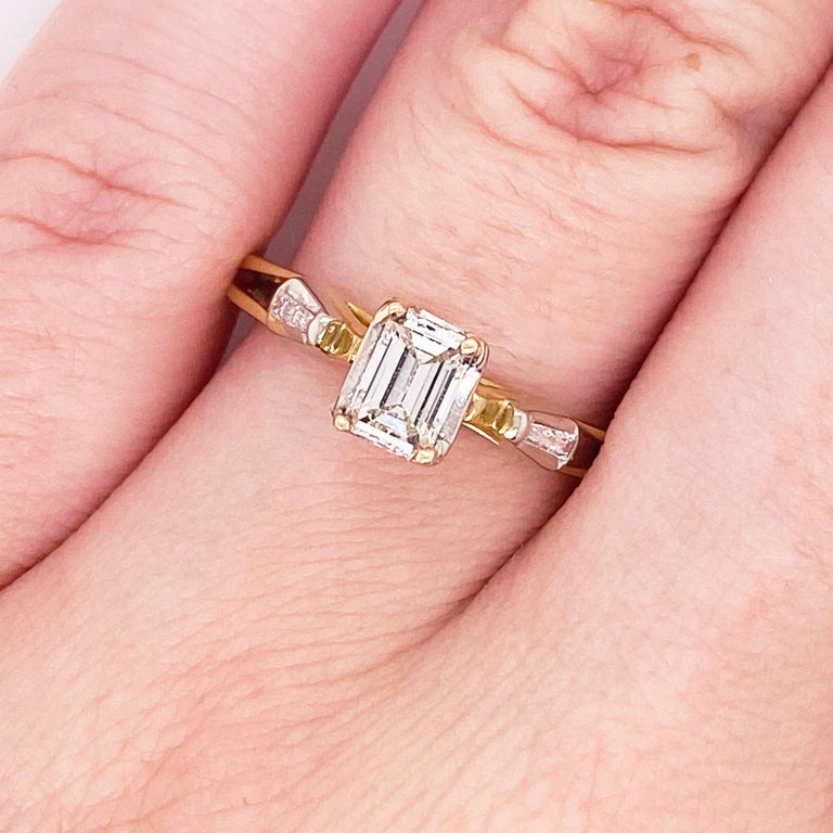 This stunningly beautiful cathedral set three stone emerald cut diamond engagement ring would make anyone thrilled to receive it! These brilliant diamonds set in polished 14k yellow gold provide a look that is very modern and classic at the same
