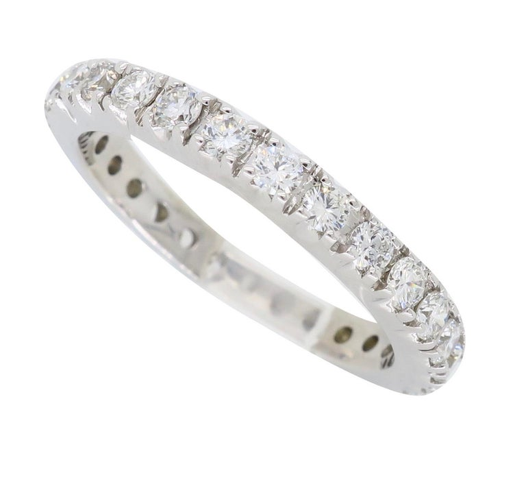 "Classic round brilliant cut eternity style diamond band.  Diamond Carat Weight: Approximately .87CTW Diamond Cut: Round Brilliant Cut Diamonds Color: Average  G-I Clarity: Average VS-SI Metal: 14K White Gold Marked/Tested: Stamped ""14K"