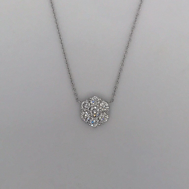 18K White gold pendant featuring 7 round brilliants weighing 1.04 carats in a floral cluster motif. Color: H-I Clarity: SI1-SI2  Available in any size, gemstone, and gold color.