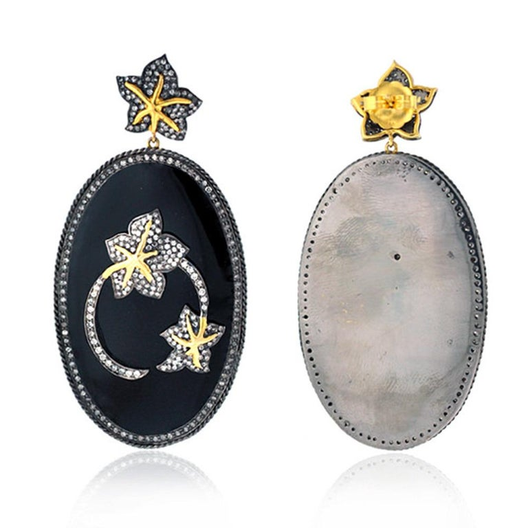 Black enamel earring with lovely diamond floral motifs on top is bold and very attractive. This earring is made in silver and gold  Closure: Push Post  14Kt: 4.28g Diamond: 3.98ct