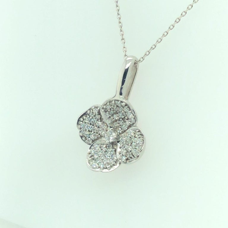 DIAMOND FLORAL PENDANT 18K WHITE GOLD  Total Carat Weight of Center Diamonds 0.08 carat  Micropave Round Brilliant Diamonds 0.77 carat  F/G Color VS Clarity  0.85 CTW of all Diamonds  With 16