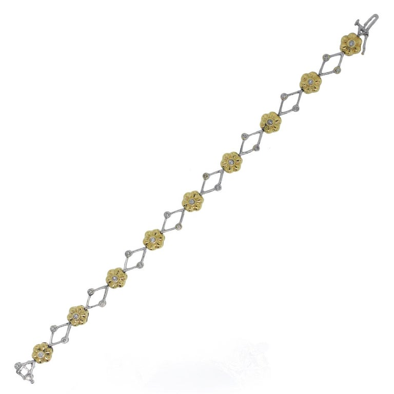 Material: 14k Yellow Gold and 14k White Gold Diamond Details: Approximately 0.45ctw round brilliant diamonds. Diamonds are J in color and SI2 in clarity. Clasp: Tongue in box clasp with safety latch Total Weight: 12.2g (7.8dwt) Length: 7