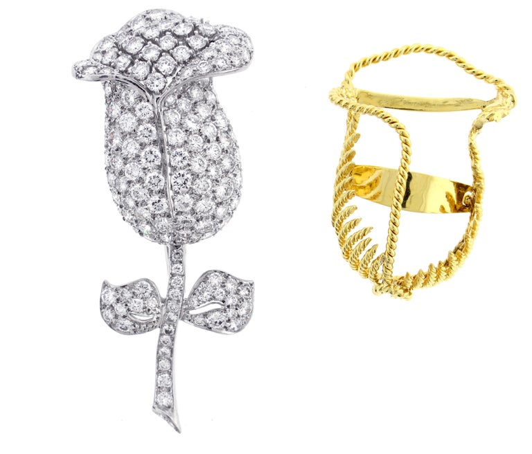 An important diamond flower brooch crafted in platinum with a elegantly engineered 18 karat gold removable jacket. The brooch boasts 153 brilliant cut diamonds weigh 10 carats. The diamond are F-G color and VS1+ clarity. The brooch stands 2 5/8th of