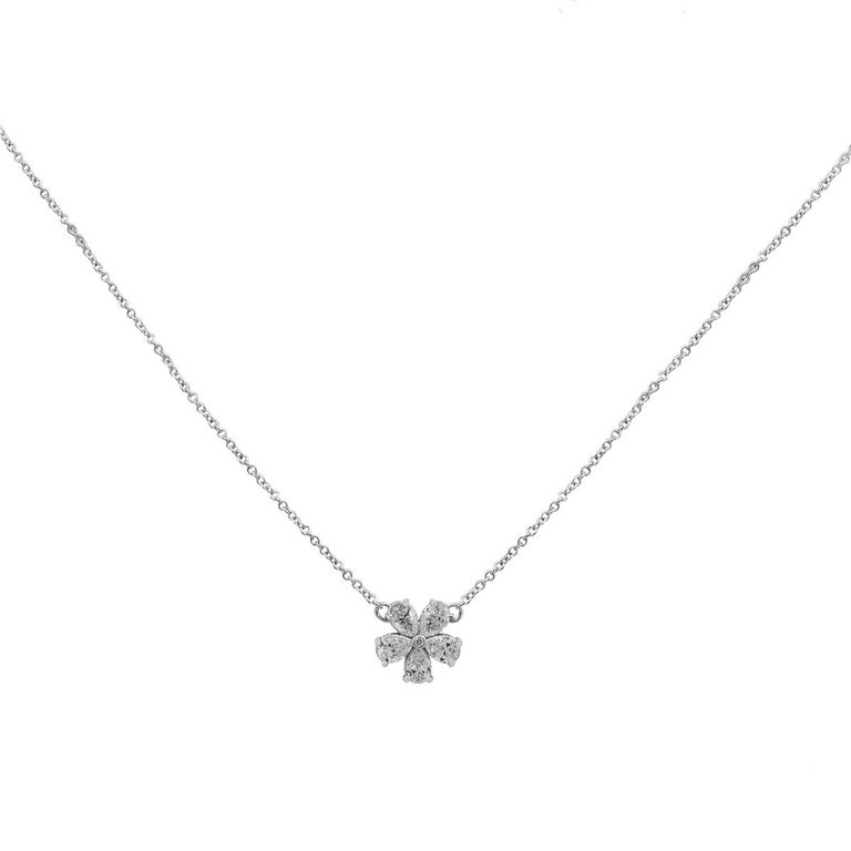 Material: 18k White Gold Diamond Details: Approximately 0.75ctw of pear shape diamonds. Diamonds are G/H in color and VS in clarity Measurements: Necklace measures 18″ in length. Pendant measures: 0.41″ x 0.13″ x 0.41″ Fastening: Lobster Clasp Item