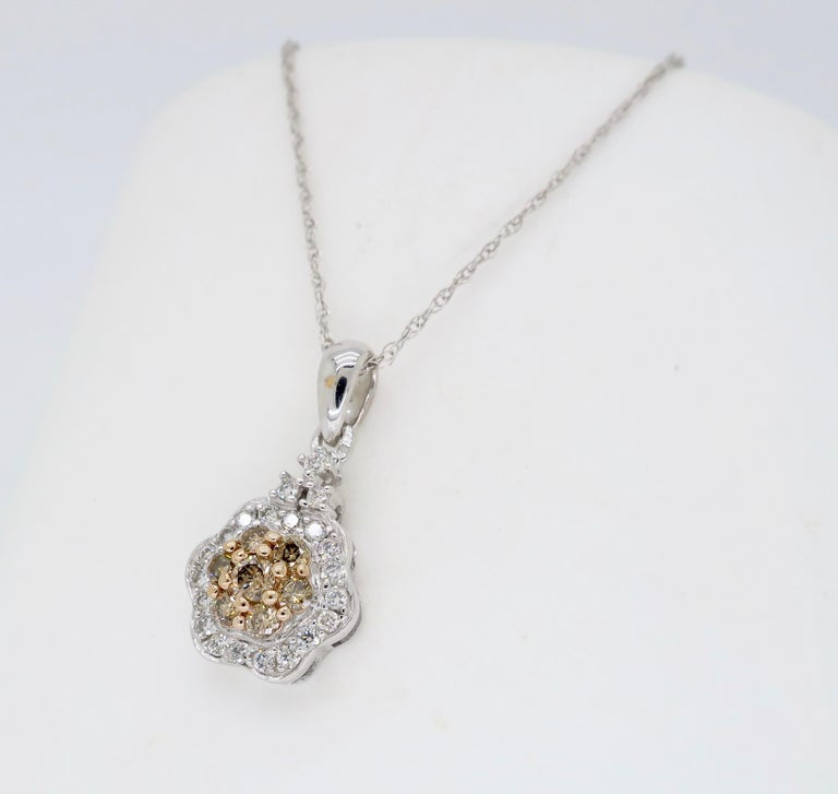 Multi colored diamond flower pendant necklace crafted in 14k white gold.  Diamond Carat Weight: Approximately .30 CTW Diamond Cut: Round Brilliant Cut Color:  Average G-I with 7 that are light brown in color Clarity: Average VS-SI Metal: 14K White