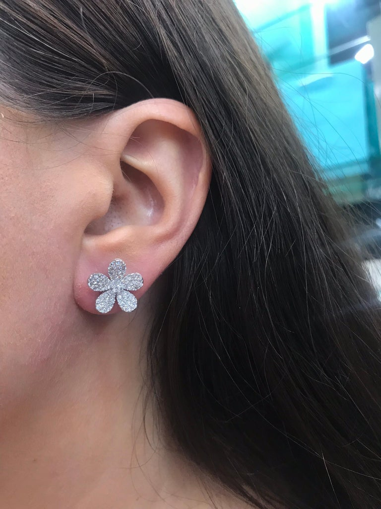 18K White Gold flower earrings featuring numerous round brilliants weighing 1.55 carats.  Color G Clarity VS  Pearl or Gemstone can be added for a Day & Night look. Email for additional information.