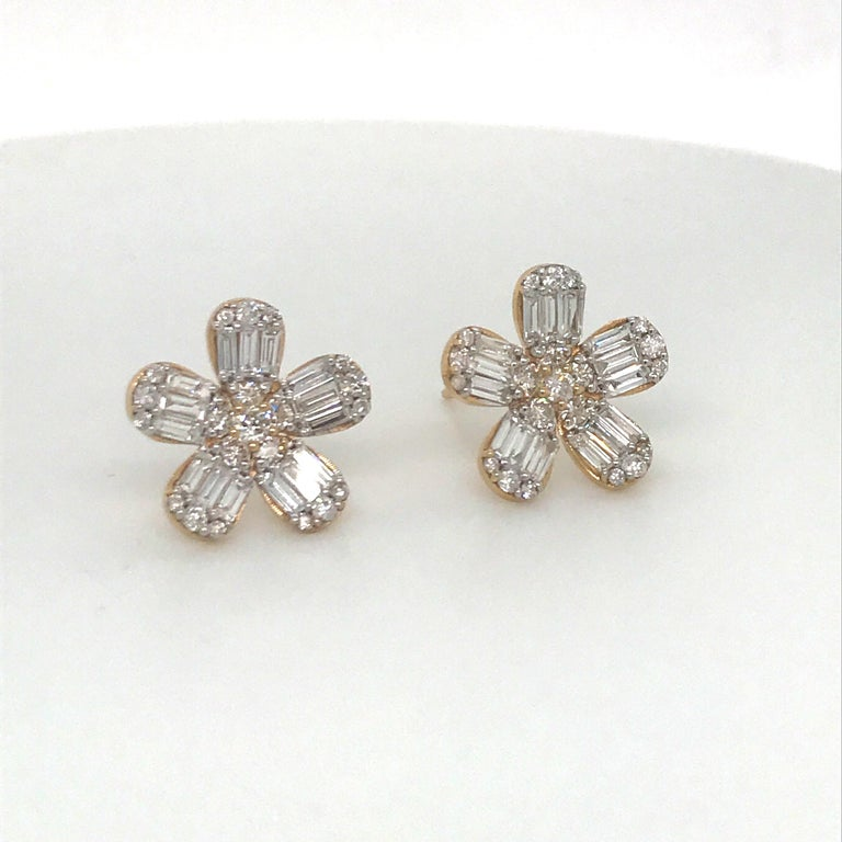 14K Rose gold floral earrings featuring round brilliant and baguette diamonds weighing 1.67 carats. Color G-H Clarity VS-SI