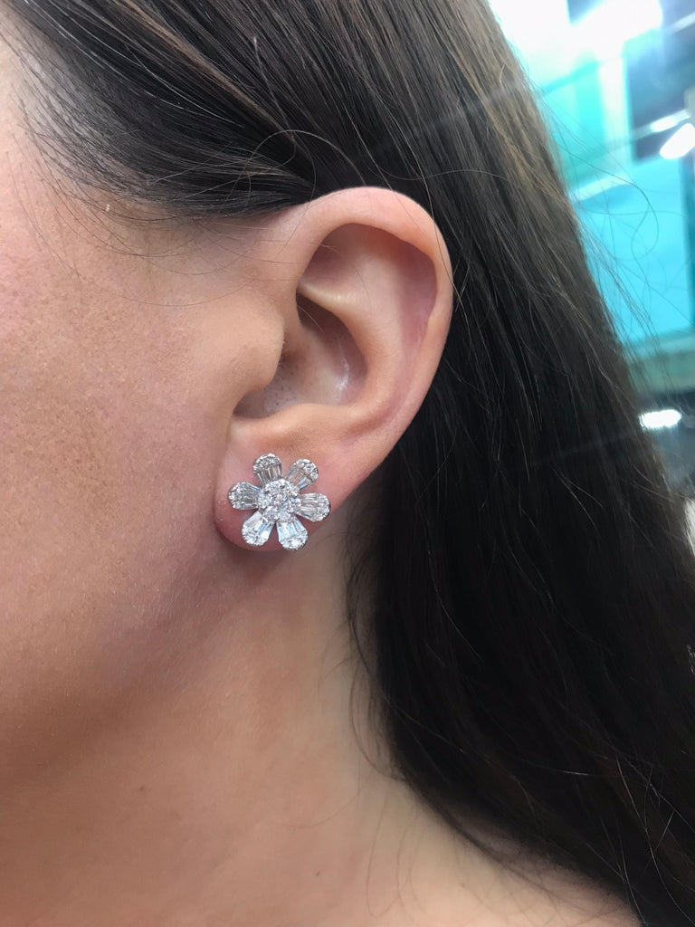 18K White gold flower earrings featuring 50 round brilliants weighing 0.93 carats and 36 tapered baguettes weighing 0.98 carats.  Total Weight: 1.91 Carats Color G Clarity VS  Pearl or Gemstone can be addition for a Day & Night look! Email for