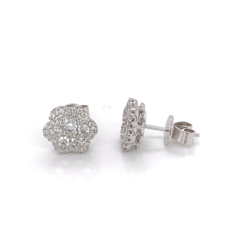 Diamond Flower Stud Earrings made with real/natural brilliant cut diamonds. Total Weight: 0.84 carats, Diamond Quantity: 62 round diamonds. Color/Clarity: H1. Set on 18 karat white gold, push back setting.
