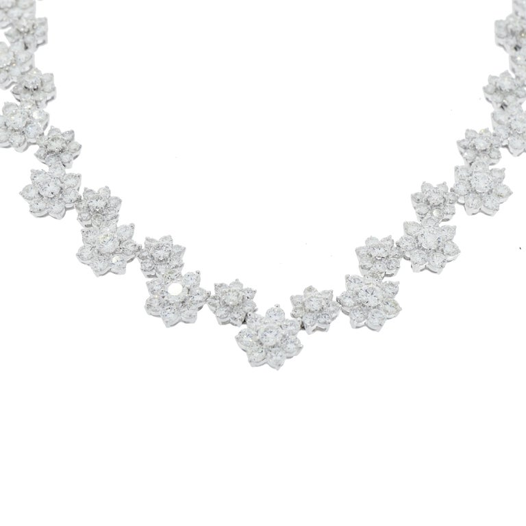 This is an exquisite Diamond Flower Necklace crafted in 18K White Gold with 400 round diamonds. G/H in color, SI1/SI2 clarity, weighing 46.20 carat total.  A classic design of floral motive comprised of 15 larger flower clusters, each center